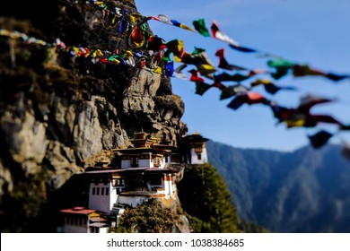 Landscape of Paro Taktsang (Tiger Nest) in Upper Paro Valley, Bhutan. Taktsang Lhakhang is Bhutan most iconic landmark and religious site. foreground prayer flag five color. focus only temple