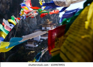 Landscape of Paro Taktsang (Tiger Nest) in Upper Paro Valley, Bhutan. Most iconic landmark and religious site. foreground prayer flag five color.