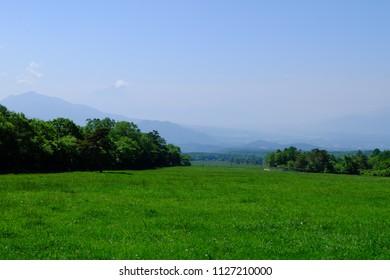 Landscape of pastures and distant mountains, Kiyosato highland, Yamanashi, Japan