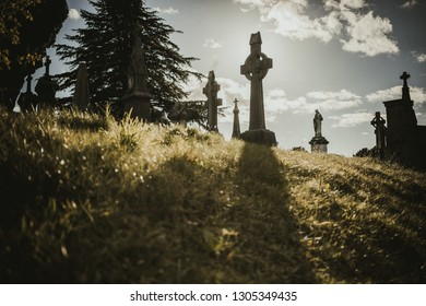 Landscape of peaceful graveyard with stone passage and tombstones in sunlight, Dublin