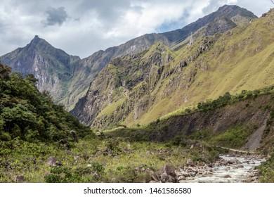 Landscape of peruvian mountains with Santa Teresa River in green lush valley. Hiking trail to Machu Picchu, Peru, South america