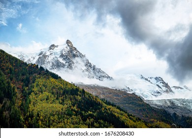 Landscape photo of Aiguille du Midi seen from Chamonix, France in autumn.