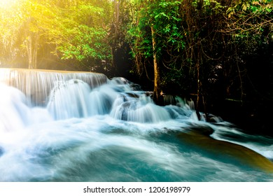 Landscape photo Amazing waterfall in wonderful autumn forest, beautiful waterfall in rainforest