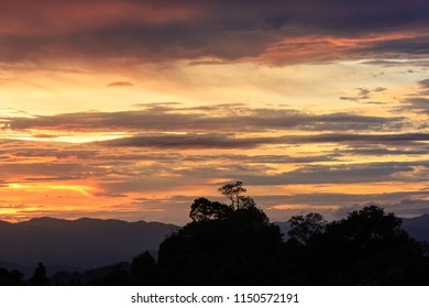 The landscape photo, beautiful mountain silhouette sunset in Thailand.