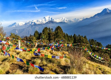 Landscape photo of beautiful sunrise and prayer flags on Poon hill in nepal