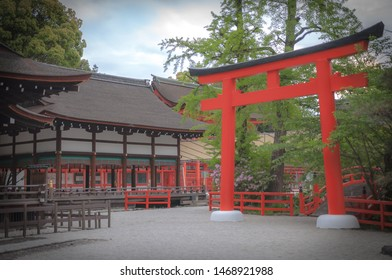 Landscape photo of a giant orange-coloured torii gate in Shimogamo Shrine which is one of the oldest shrines and is also one of the many UNESCO World Heritage Sites located in Kyoto City, Japan.