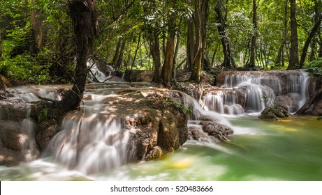 The landscape photo, Kroeng Krawia Waterfall, beautiful waterfall in tropic forest, Kanchanaburi province, Thailand. Long exposure