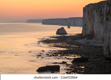 Landscape photo with a look along the chalk cliffs at sunrise. Etretat, Normandie, France