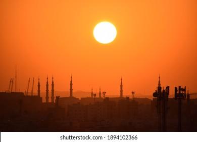 Landscape photo of the Nabawi mosque tower at sunrise. Madinah, Saudi Arabia, October 10, 2020