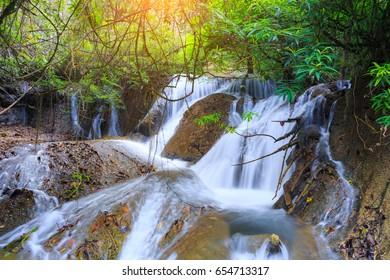 Landscape photo, Pha Tak Waterfall, beautiful waterfall in rainforest at Khao Laem National Park in Kanchanaburi,Thailand.