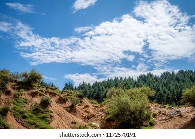 Landscape photo of rain water erosion landcape with blue cloudy sky