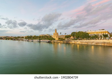 A landscape photo of the Torre del Oro in Seville next to the Guadalquivir River.