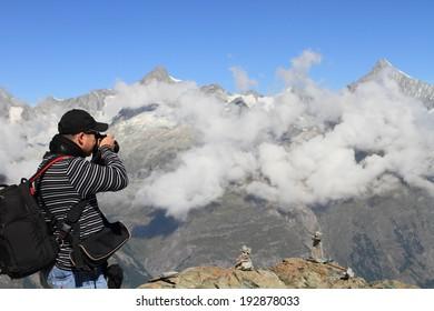 landscape photographer on the alps