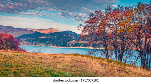 Landscape photography. Panoramic autumn view of Roselend lake (Lac de Roselend). Majestic morning scene of Auvergne-Rhone-Alpes, France, Europe. Beauty of nature concept background.
