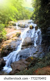Landscape photo,Ngao Waterfall, beautiful waterfalls in the high mountain rainforest in Ranong Province, Thailand.