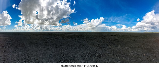 Landscape picture of the large salt pan at the Etosha Nationalpark  in northern Namibia during summer