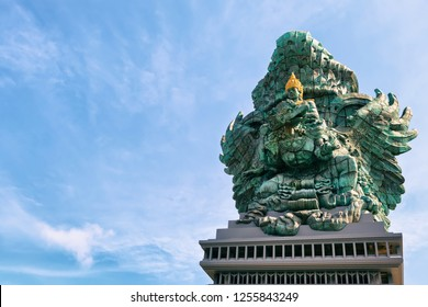 Landscape picture of old Garuda Wisnu Kencana GWK statue as  Bali landmark with blue sky as a background. Balinese traditional symbol of hindu religion. Popular travel destinations in Indonesia.