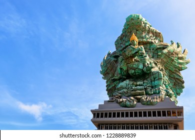 Landscape picture of tallest Garuda Wisnu Kencana GWK statue as  Bali landmark with blue sky as a background. Balinese traditional symbol of hindu religion. Popular travel destinations in Indonesia.
