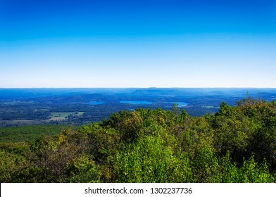 A landscape picture of Twin Lakes and Salisbury from the top of Bear Mountain in Salisbury Connecticut on a sunny day.