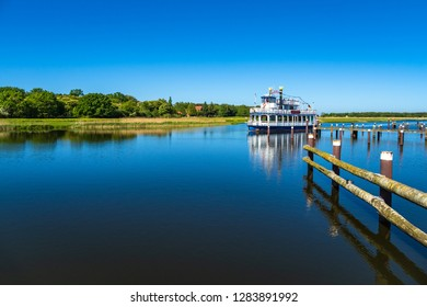 Landscape with pleasure boat in Prerow, Germany.
