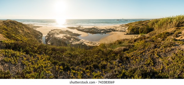 Landscape of Porto Covo beach, Portugal at sunset.