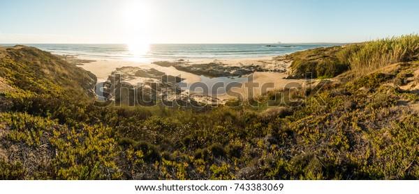 Landscape of Porto Covo beach, Portugal at sunset.