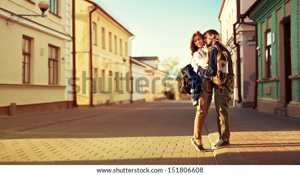Landscape portrait of young beautiful stylish couple sensual and having fun outdoor in summer.