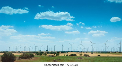Landscape with power generating windmills