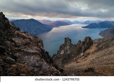 Landscape of Providence Bay and the Bering Sea coast. View from the rocks on the mountain Whirlwind. Provideniya, Chukotka, Russia.