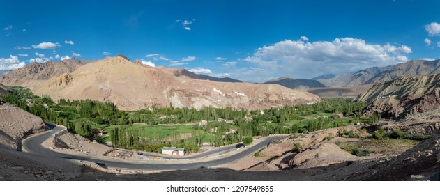 Landscape of range mountains and road with blue sky and clouds in Leh, Ladakh, India.