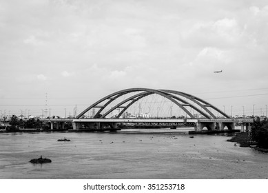 Landscape of red bridge and plane. Black and white