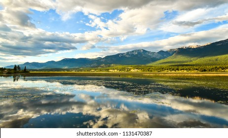Landscape Reflection of the Rocky Mountains in the Columbia Wetlands in Fairmont Hot Springs, British Columbia, Canada