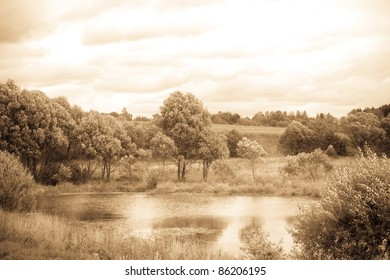 Landscape with river, antique light toned