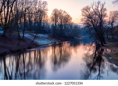 Landscape of the river in late autumn at sunset