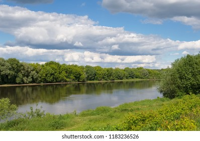 Landscape with a river. Summer. View in the distance
