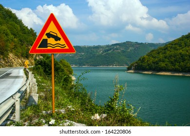 Landscape with Road Ends Sign beside the lake