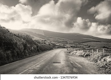 Landscape with road and hills in south west of Ireland. Black white.