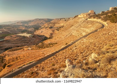 Landscape with road leading to crusader castle Kerak  (Al Karak), Jordan