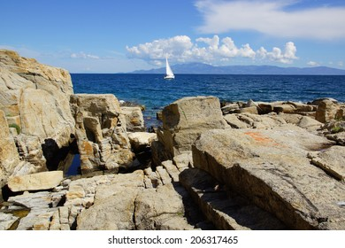 landscape with rock beach and greek island view