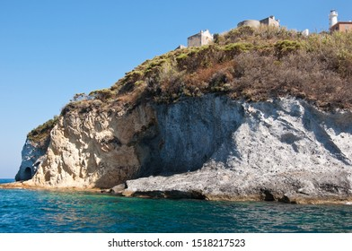 Landscape of the rocky cliff of the island of Ponza. Rocky shore of the famous island of volcanic origin of the central Italy.
