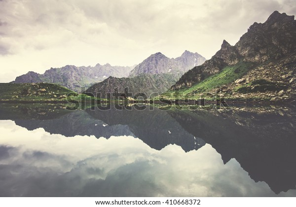 Landscape Rocky Mountains and Lake mirror reflection with moody sky clouds Summer Travel serene view