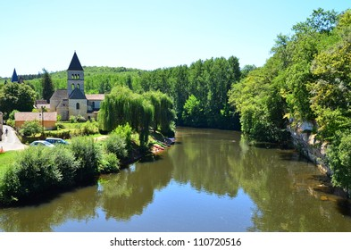 St-Léon-sur-Vézère, landscape  with roman church  at the river Vézère in the Dordogne, France