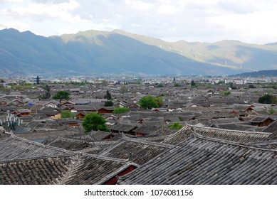 Landscape Rooftops of Lijiang old town with mountain background is  traditional Chinese house at Lijiang Yunnan province, China