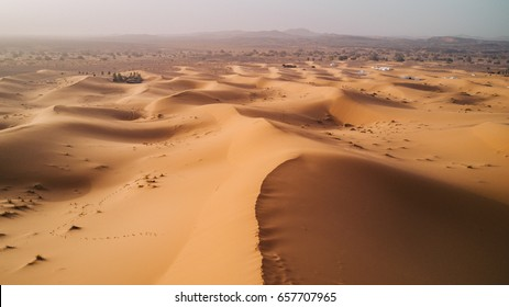 Landscape of the Sahara Desert, the western part of the Sahara Desert at Merzouga, Morocco, North Africa, Africa. The Sahara Desert is the world's largest hot desert. Aerial view.