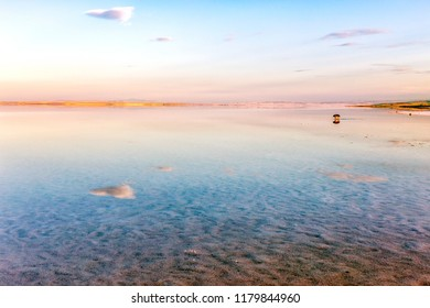 Landscape of the salt lake ( Turkish: Tuz golu ) and cloud reflection to lake. The lake occupying a tectonic depression in the central plateau of Turkey is fed by two major streams and groundwater.