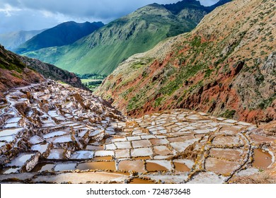Landscape of the salt terraces of Maras ( Salineras de Maras) in the Andes mountain range in the region of Cusco, Peru, Sacred Valley