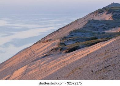 Landscape of sand dune and waters of Lake Michigan, Sleeping Bear Dunes National Lakeshore, Michigan, USA