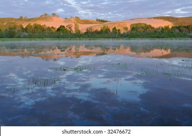 Landscape of sand dunes and reflections in calm water, Sleeping Bear Dunes National Lakeshore, Michigan, USA