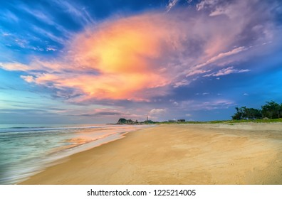 Landscape of sandy beach in the morning with dramatic sky beautiful welcomes new day