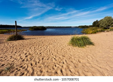 Landscape with a sandy beach and the water in late summer. Finland